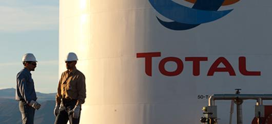 Total : annulation d'actions, changement de nom et baisse du dividende